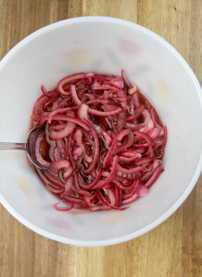 A bowl of red onions after the vinegar has pickled them.