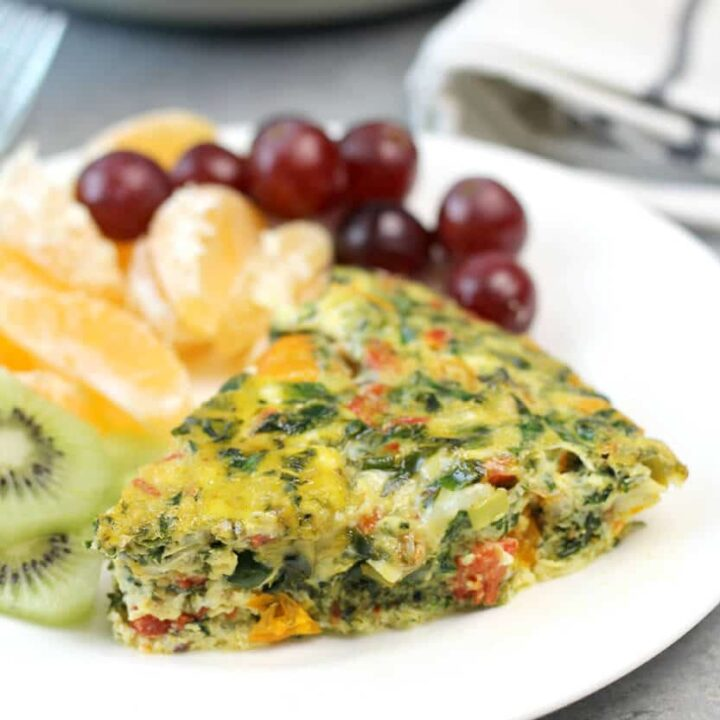 Easy Crustless Quiche Recipe made with spinach, peppers, onion--or whatever vegetables you have on hand! It's simple and keeps for days in the fridge.