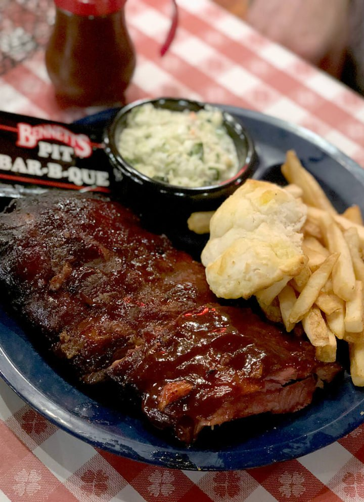 A plate of ribs, fries, slaw, and biscuit from Bennett's BBQ in Pigeon Forge.