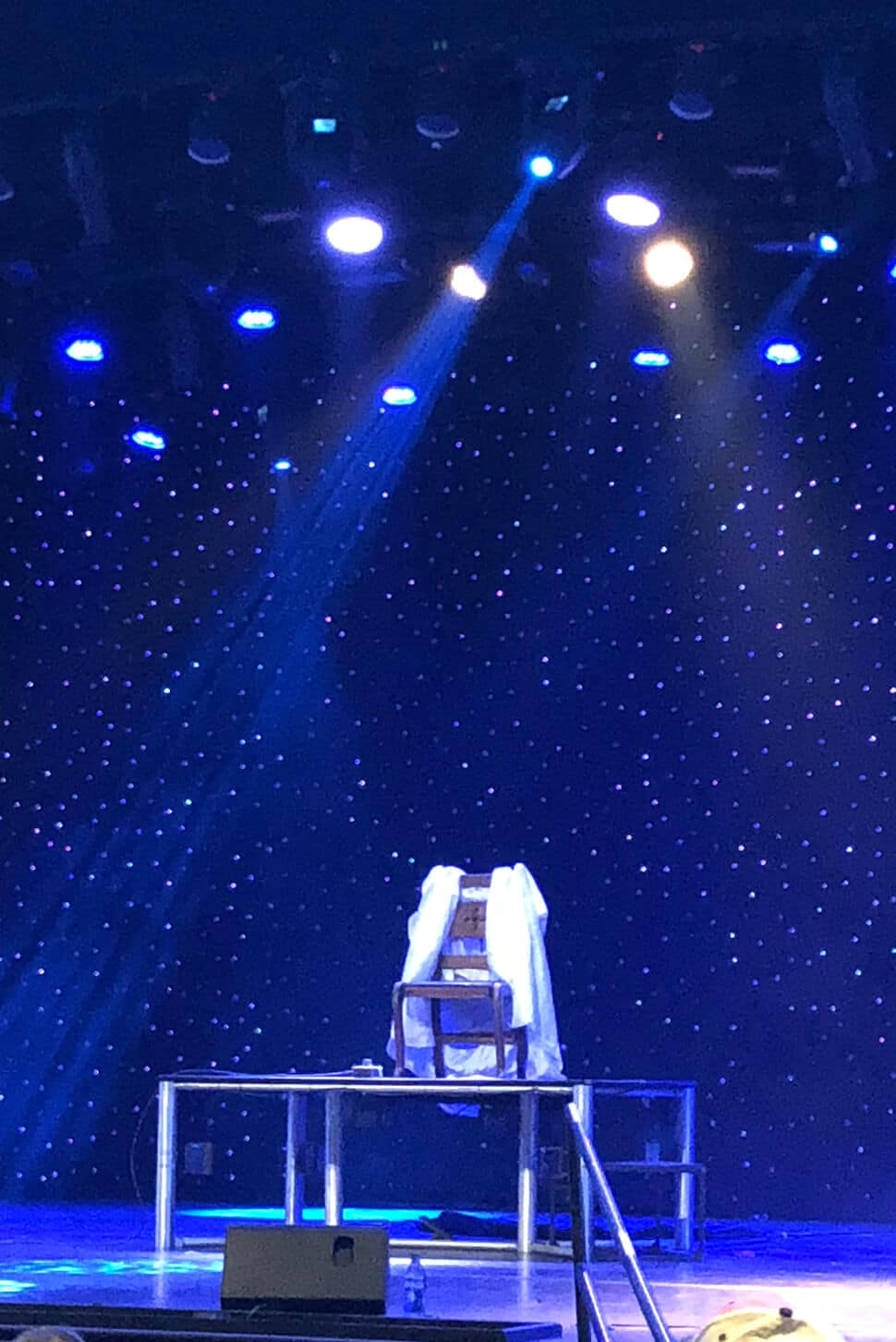 An empty chair on the stage in the show Magic Beyond Belief in Pigeon Forge.