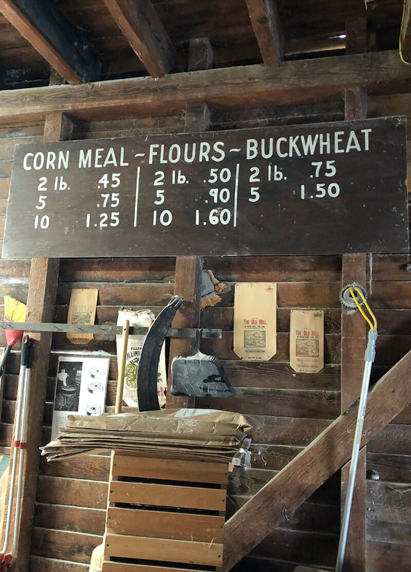 An old sign with the prices of cornmeal and flours in the Old Mill Pigeon Forge.