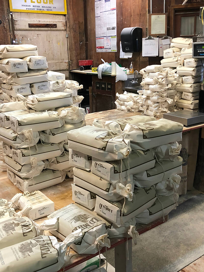 Stack of freshly ground flour and meal inside the Old Mill Pigeon forge.