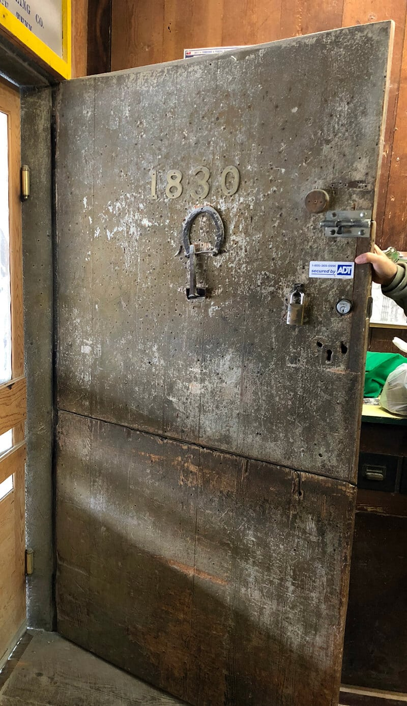 The exterior door to the Old Mill Pigeon Forge, which was used as a town bulletin board.