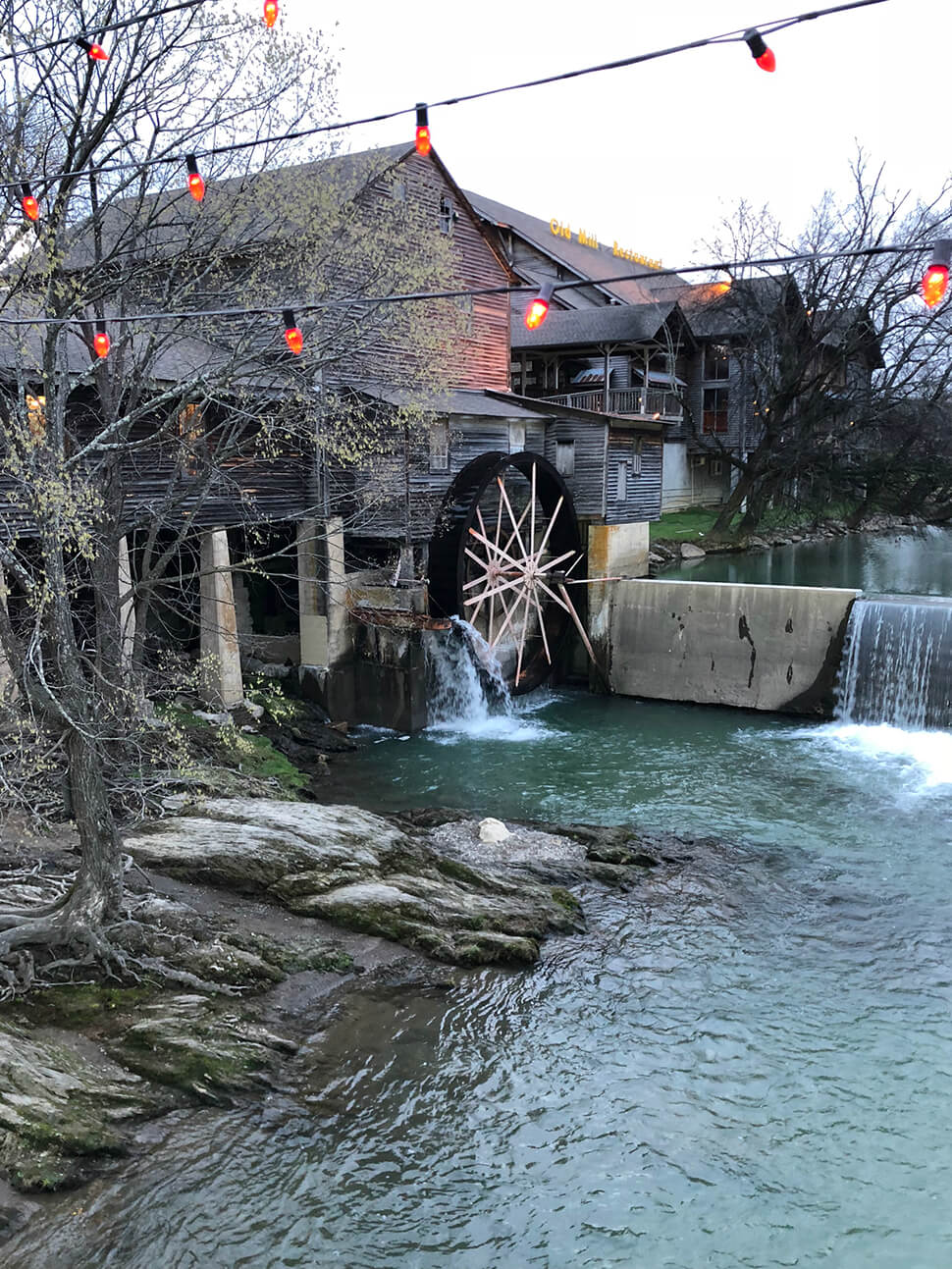 The old water wheel in the river outside the Old Mill Restaurant in Pigeon Forge.