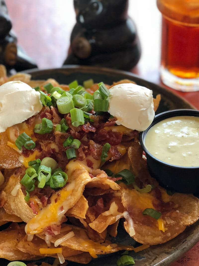 A plate of loaded homemade potato chips from the Pottery House Cafe.
