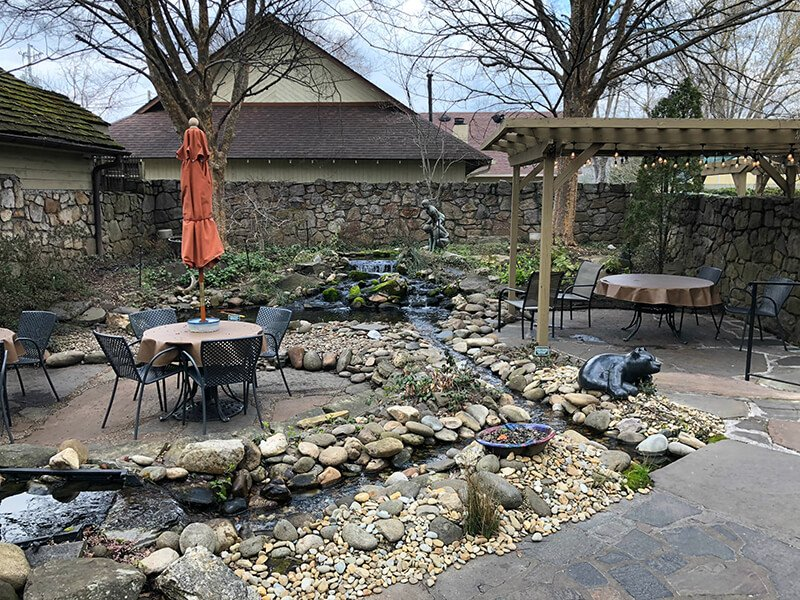The outdoor courtyard at the Pottery House Cafe one of the best Pigeon Forge restaurants.