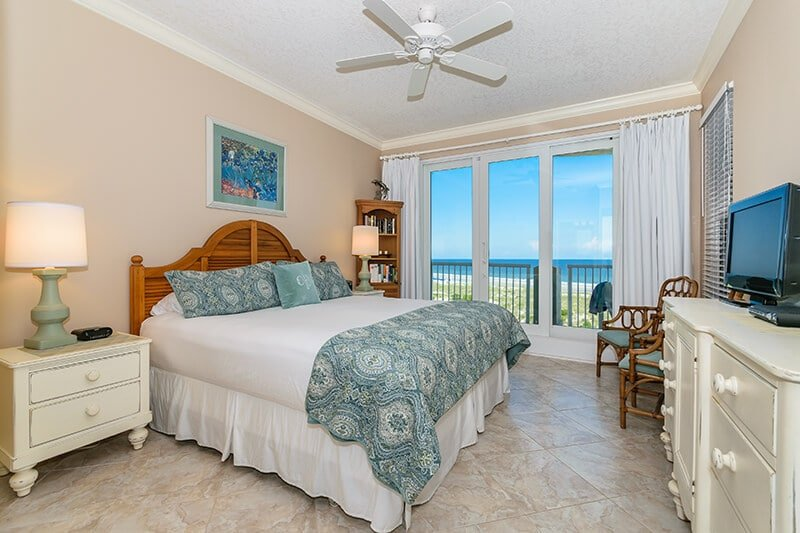 The master bedroom and balcony view from Amelia Island rental.