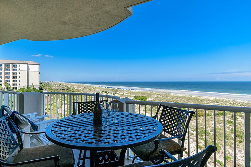 Enjoy a glass of wine on your Amelia Island balcony overlooking the Atlantic Ocean.