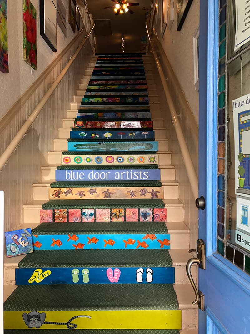 Painted stairs leading up to the Blue Door Artists studio in Amelia Island.