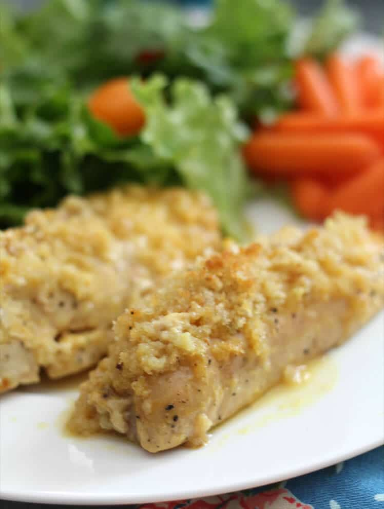 Honey Mustard Chicken tenders on a plate with salad and carrots.