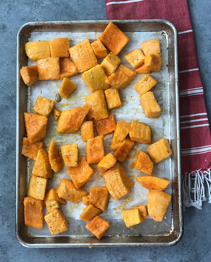 Squash on pan ready to roast for butternut squash soup.