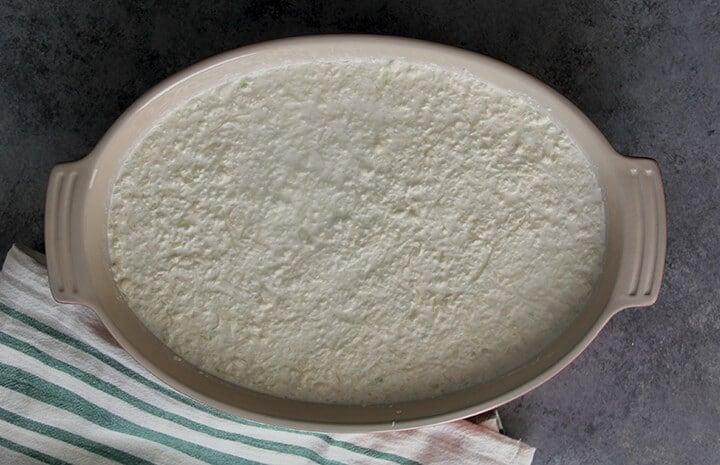 A dish of Vidalia onion dip ready to bake.
