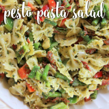 This colorful Pesto Pasta Salad features a zippy lemon basil pesto salad dressing, along with bowtie pasta, sundried tomatoes, asparagus, artichoke hearts, and more lemon zest...it's overflowing with flavor and color and pizazz!
