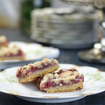 Featured photo of raspberry bars on a plate for the Recipes page.