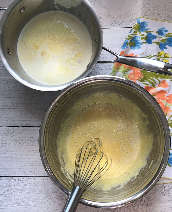 A pot of whisked eggs and a pot of milk to temper for Southern Banana Pudding.
