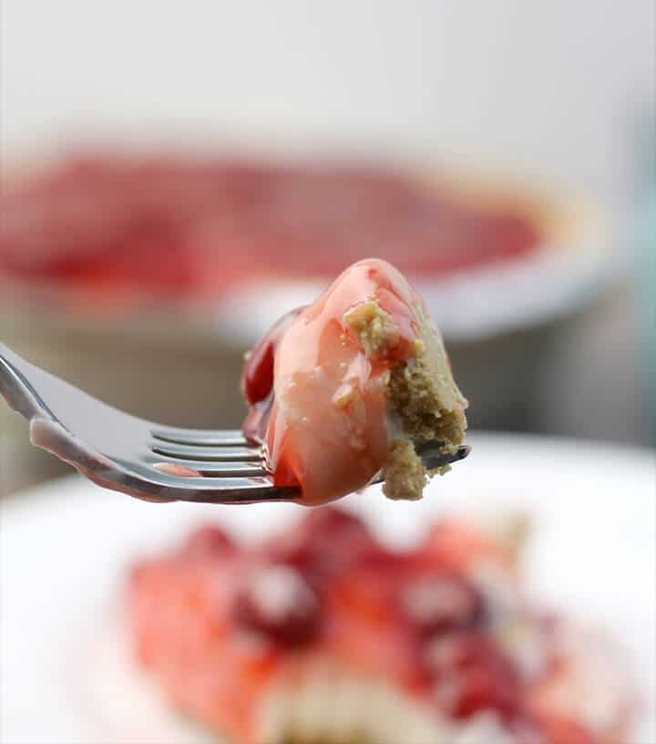 A bite of cherry cream cheese pie on a fork.