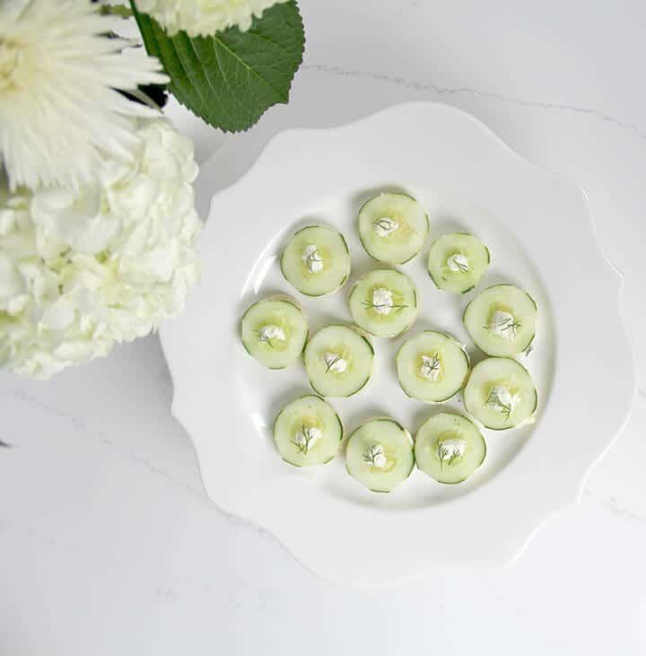 Overhead photo of a plate of cucumber tea sandwiches.
