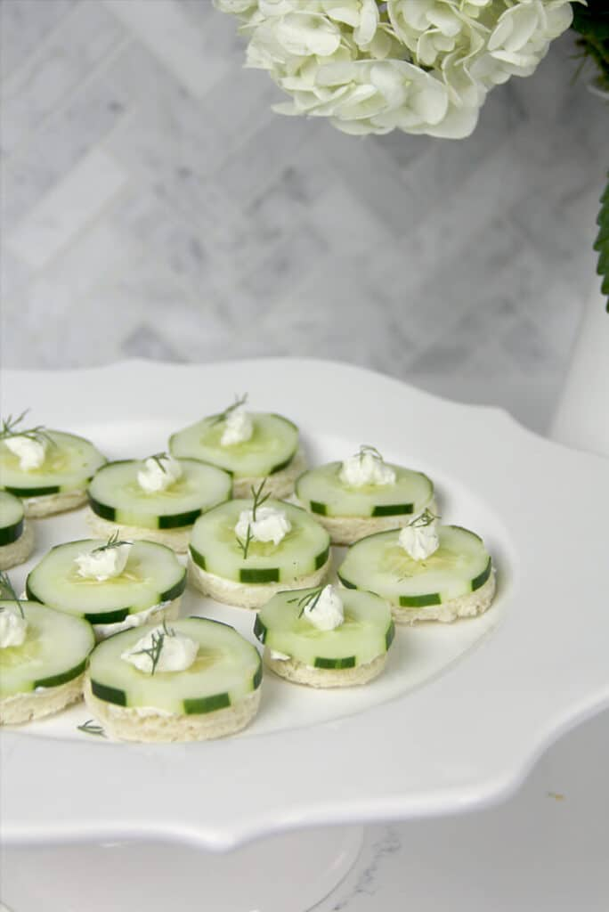 Cucumber sandwiches on a platter ready to serve.