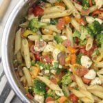 Pizza Pasta Salad with pepperoni, peppers, tomatoes, and mozzarella balls is super easy--and perfect for tailgates. Minimal chopping is required and you can mix and match ingredients.