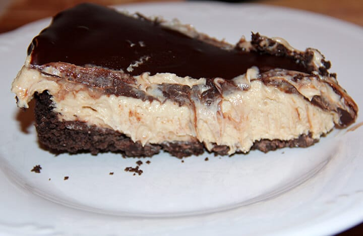 A slice of chocolate peanut butter pie on a plate.