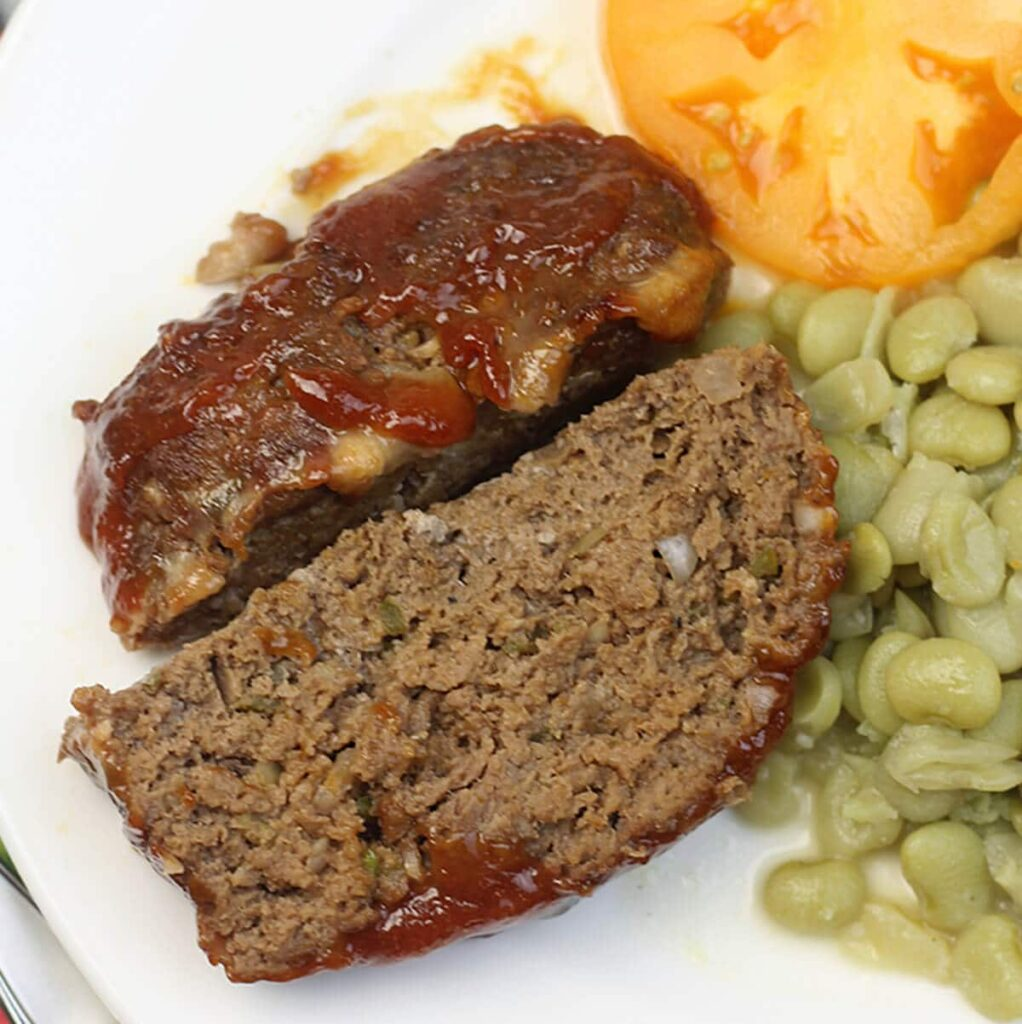This Southern Meatloaf Recipe is a simple classic, with onions and green peppers and not much else. This is the way Mom made meatloaf!