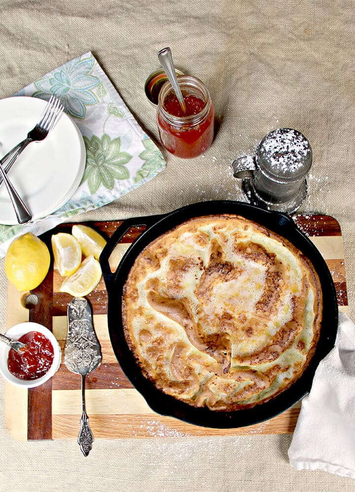 Overhead photo of a plain Dutch baby pancake in a cast iron skillet.
