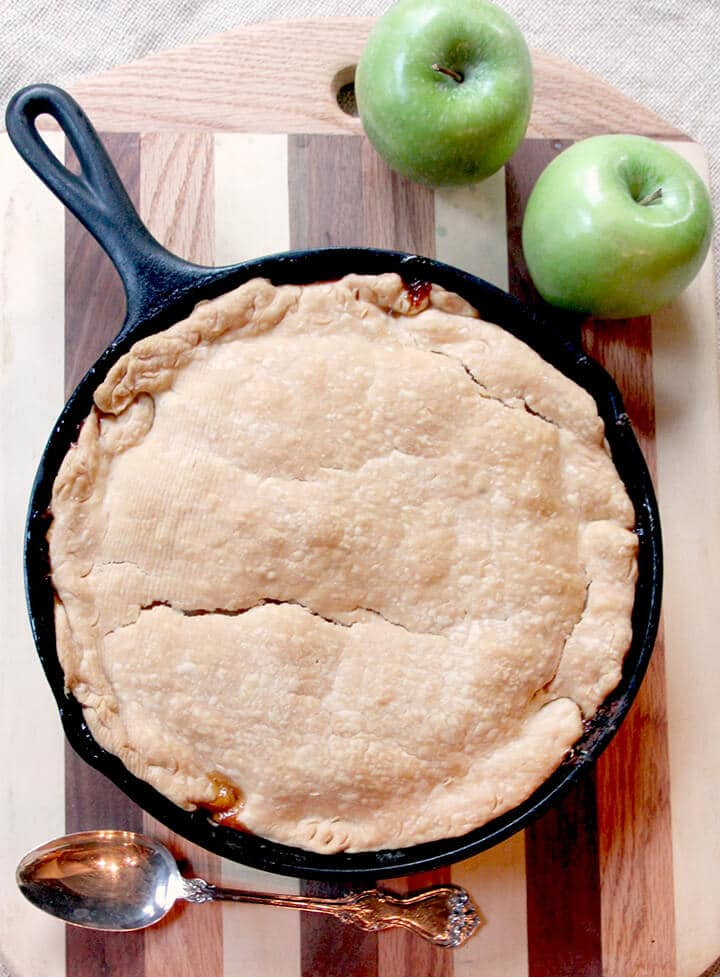 overhead photo of apple tarte tatin crust in a skillet.