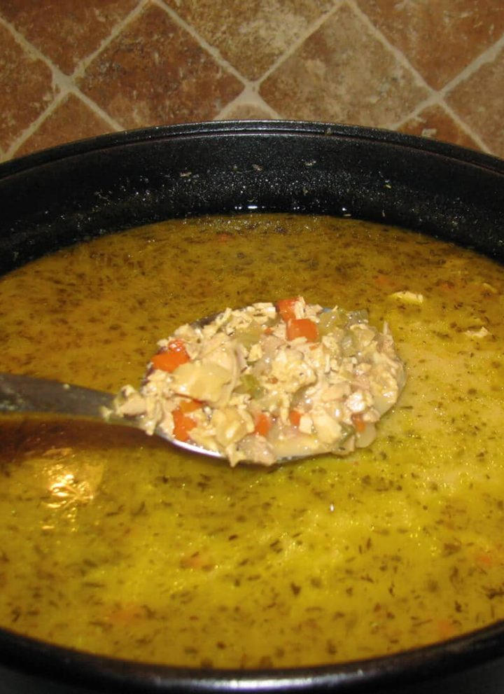 Large pot of Southwest Chicken Soup with a spoonful over the pot.