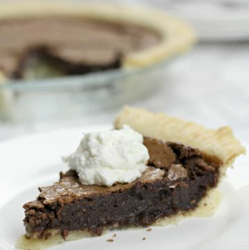 A slice of easy fudge pie on a white plate.