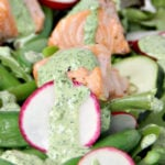Roasted salmon on a spring vegetable salad with asparagus, edamame, sugar snap peas, and green goddess dressing.