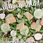 Spring salad recipe bursting with fresh vegetables like asparagus, edamame, sugar snap peas, arugula, radishes, and more—topped with easy baked salmon and drizzled with homemade Green Goddess Dressing. It's fresh, beautiful, and healthy!
