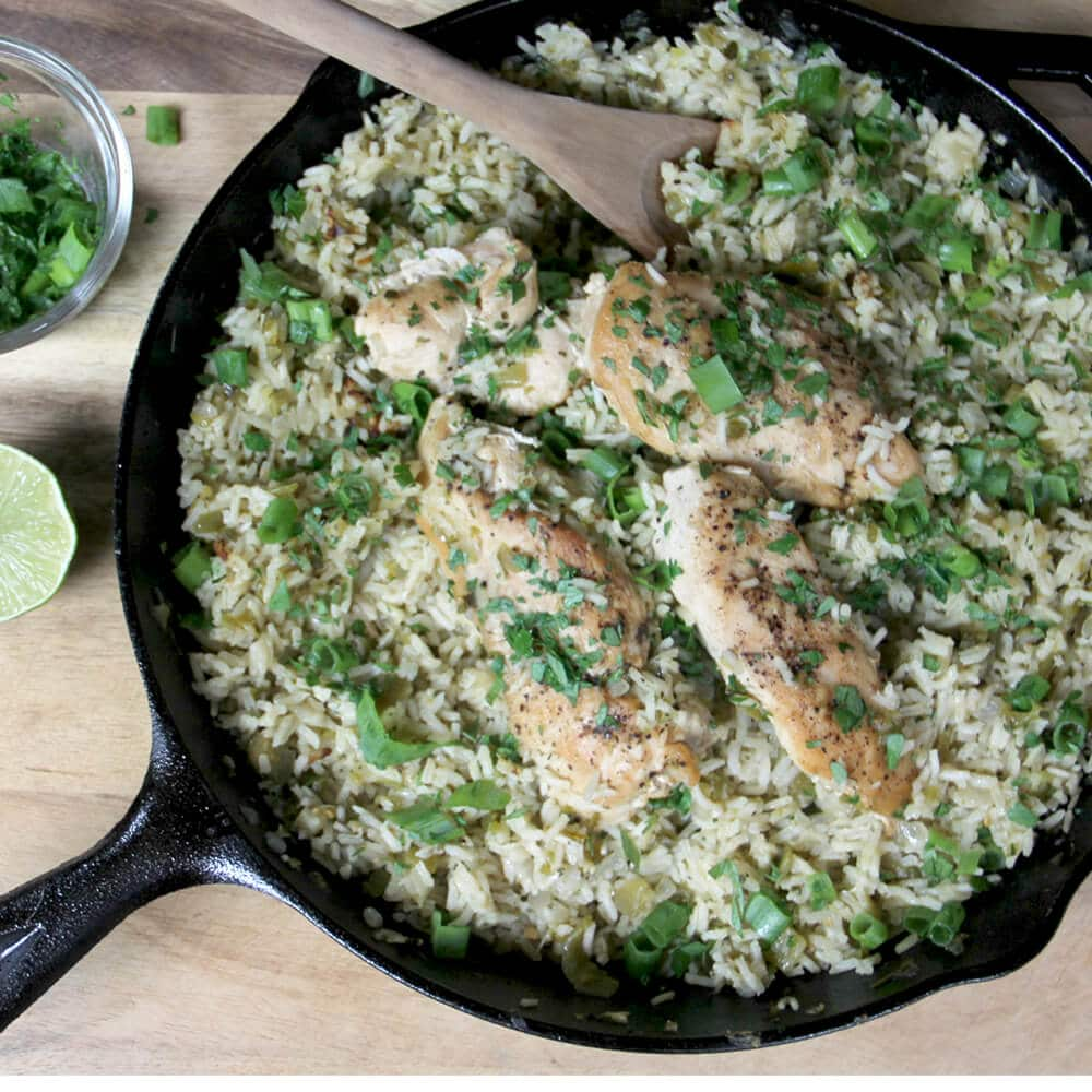 Gluten free chicken and rice in a cast iron skillet.