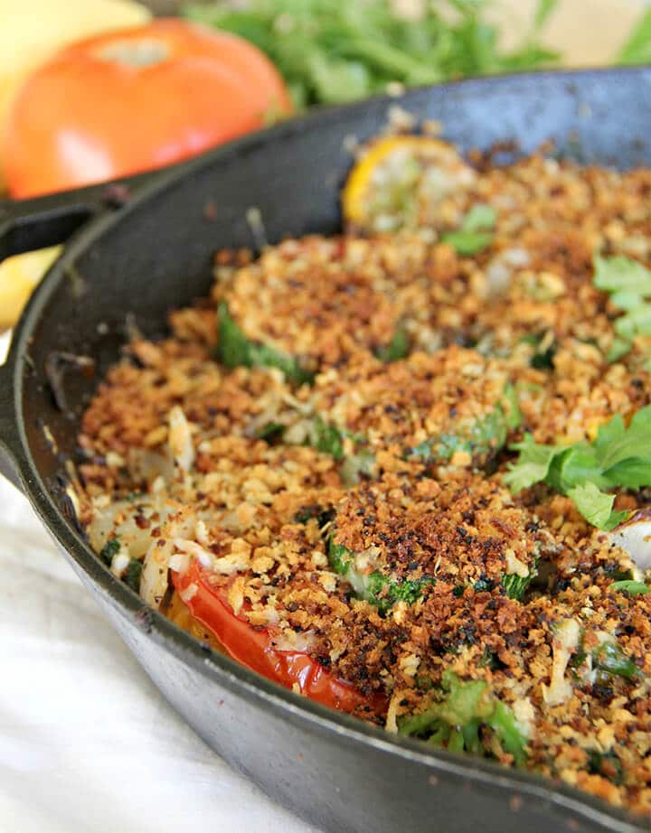 A cast iron skillet filled with a crispy vegetable gratin without cream.