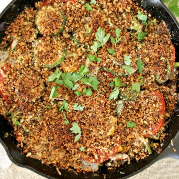 Summer vegetables roasted in a cast iron skillet with toasted breadcrumbs.
