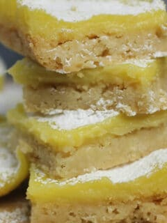 Easy lemon bars with a zesty lemon custard over a crisp brown sugar shortbread crust—these lemon bars are lovely and delicious!