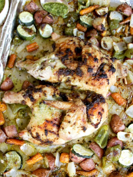 Pesto Chicken with Roasted Vegetables is a low-carb, nutritious, one pan dinner that everyone loves. You can use homemade or store-bought pesto and almost any mixture of vegetables.
