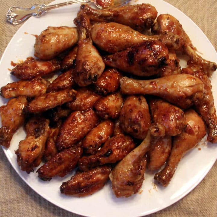 Honey Baked Chicken Wings on a white plate.