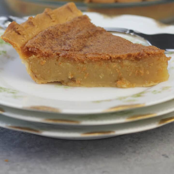 A plate with a slice of chess Pie which is an old-fashioned Southern favorite custard-type pie made from a few simple ingredients. It's easy and everyone loves it!