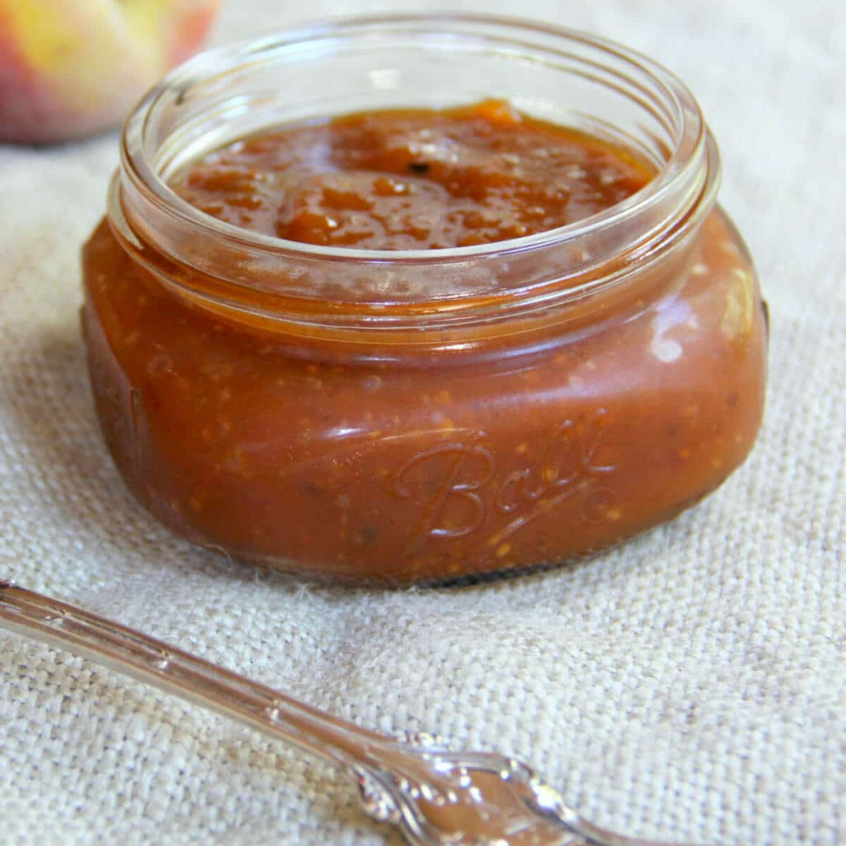 Peach BBQ Sauce with Bourbon is sweet and tangy, flavored with jalapeno pepper and sweet onion. This sauce is great slathered on chicken, pork chops, ribs, or even grilled salmon.