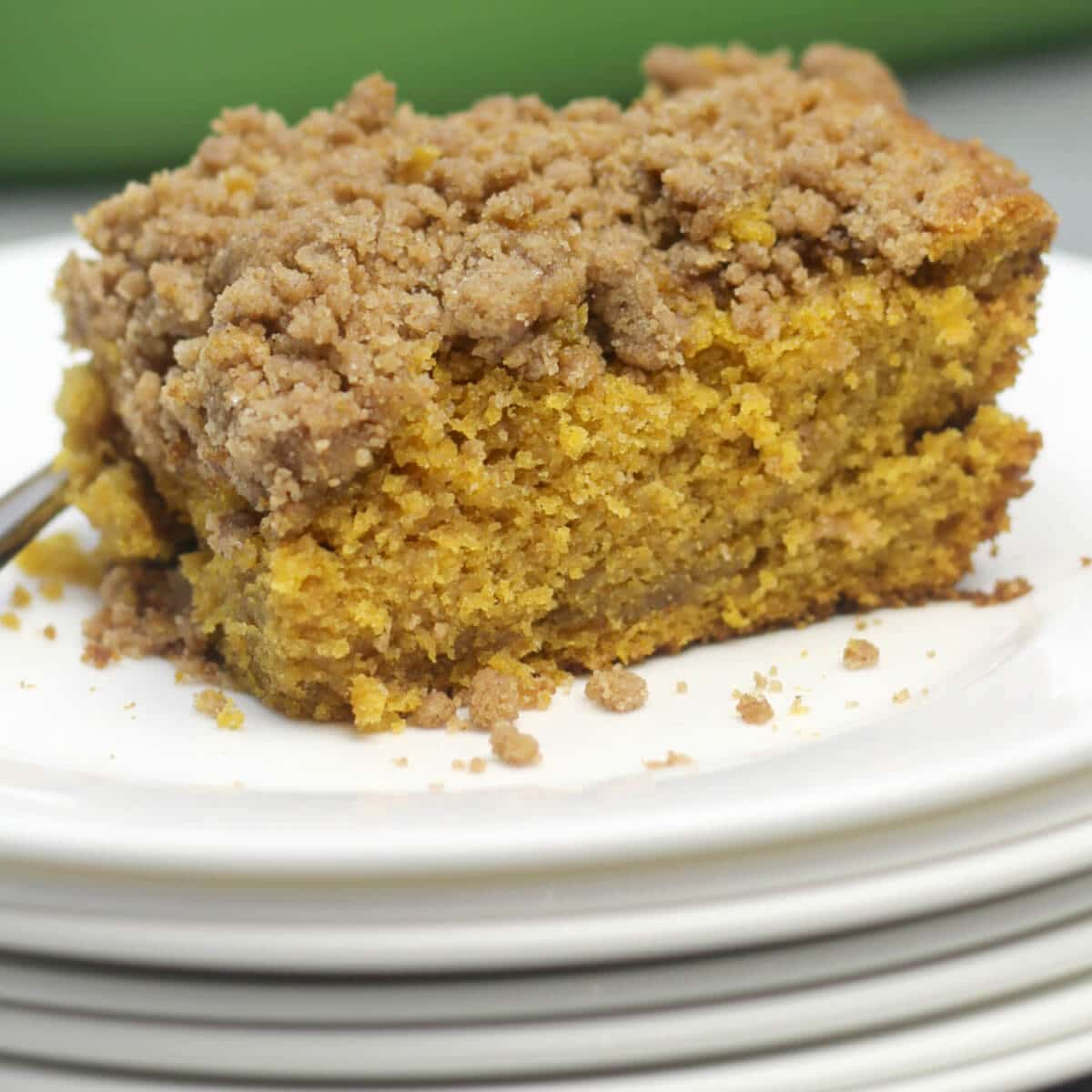 A slice of pumpkin crumb cake on a white plate.