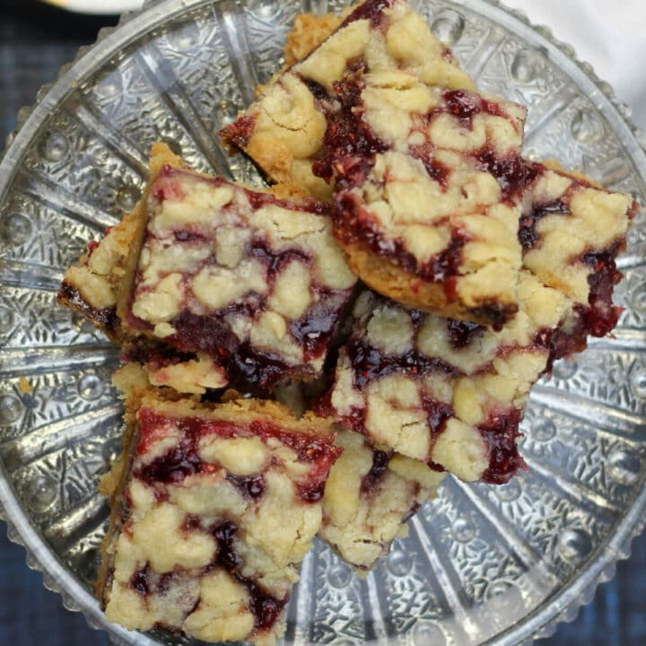 Raspberry shortbread bars on a silver platter.