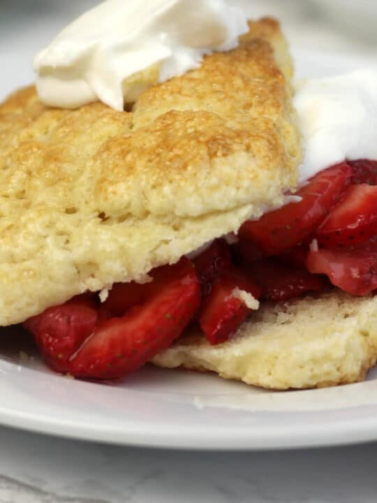 Strawberry shortcake recipe with easy, homemade biscuits using cream and brown sugar.