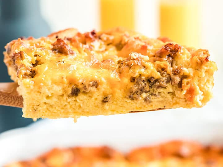 A serving of overnight breakfast casserole on a spatula.