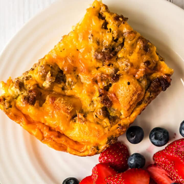 Overnight breakfast casserole that you can whip up in about twenty minutes, stick in the fridge, and bake in the morning. This one features sausage and egg, with lots of cheese!