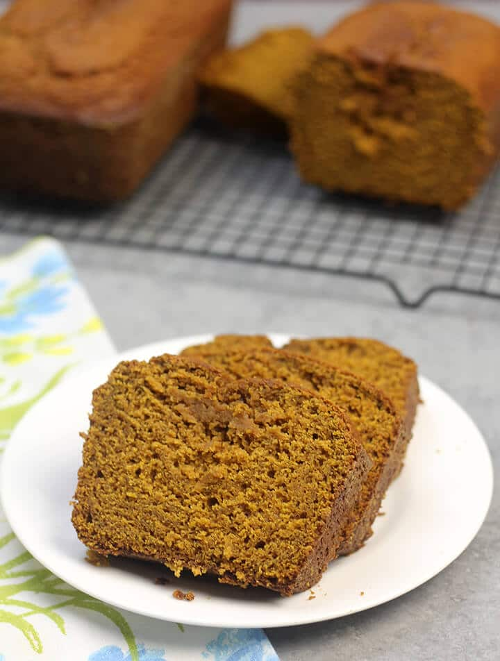Slices of pumpkin bread on a white plate.