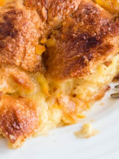 Croissant breakfast casserole made with orange marmalade, eggs, and cream—luscious, and super easy. Prepare ahead and bake in the morning!