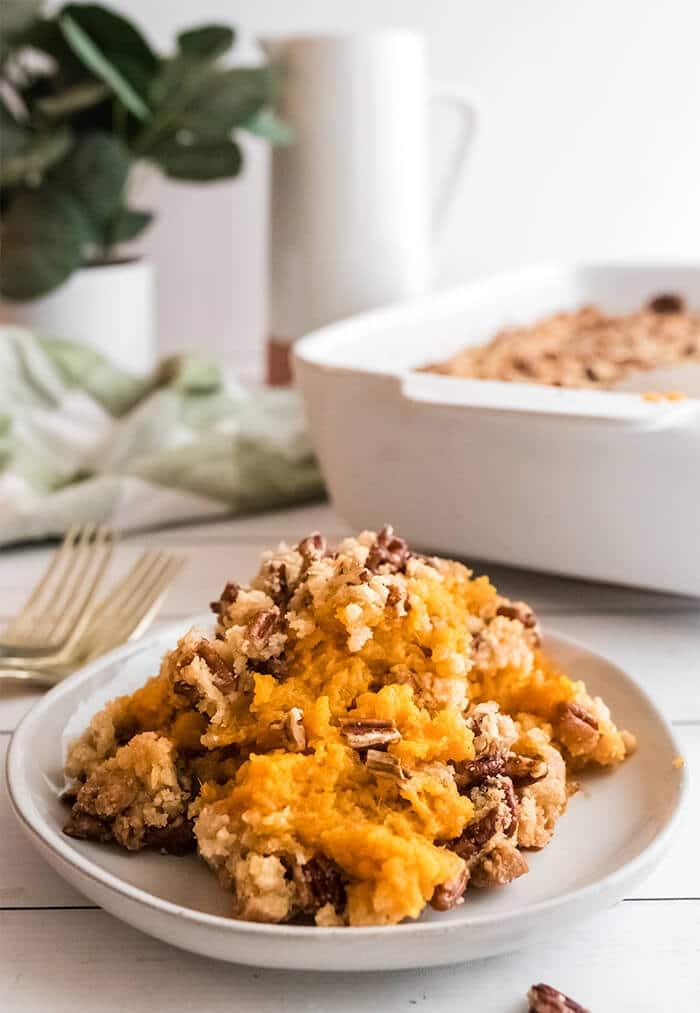 Single serving of Southern sweet potato casserole on a white plate.