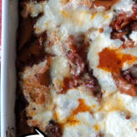 This easy pasta bake is great with chicken or Italian sausage. Everything goes in one pot and then into a baking dish. It's so easy and ready in just over an hour.