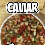 Texas Caviar Dip is made with shoepeg corn, black-eyed peas or black beans, fresh tomatoes, lots of chilis, and a tangy red wine vinegar dressing.